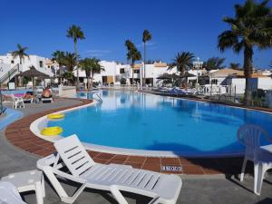 The swimming pool at or near Caleta de Fuste Luxury Apartment