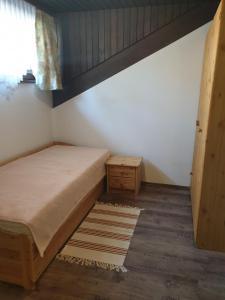 A bed or beds in a room at Villa Grossglockner Heiligenblut