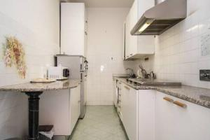 A kitchen or kitchenette at Frattina De Luxe