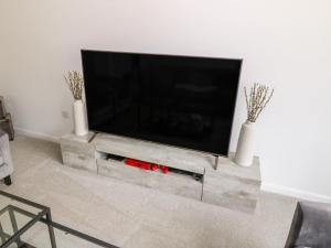 A television and/or entertainment center at 6 Whitecraigs Crescent