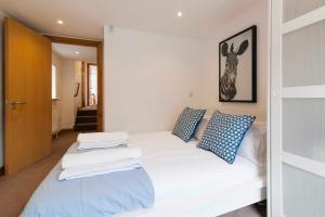 A bed or beds in a room at The Fulham Mirabel Gem