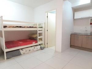 A bunk bed or bunk beds in a room at DELETAR Galeria