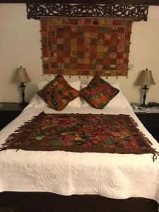 A bed or beds in a room at La Cazetta