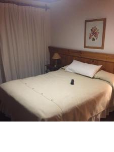 Una cama o camas en una habitación de Apartamento en Hosteria del Cerro