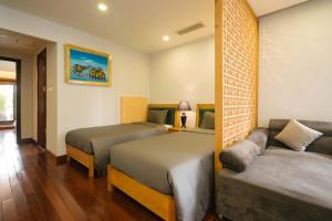 A bed or beds in a room at Zody Premium Apartment