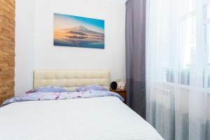 A bed or beds in a room at StudioMinsk 16 Apartments
