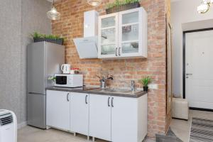A kitchen or kitchenette at StudioMinsk 16 Apartments