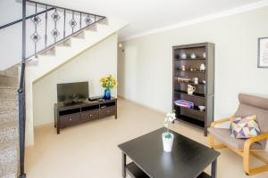 A television and/or entertainment centre at Sunny Golf Villas