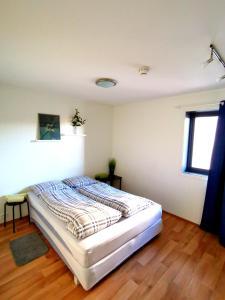 Кровать или кровати в номере Ilevegen 15