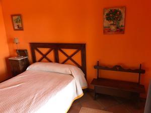 Cama o camas de una habitación en Casa rural Los Robles