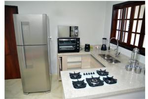 A kitchen or kitchenette at Casa linda Rio de Janeiro