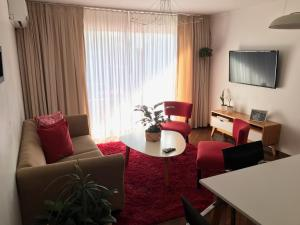 Un lugar para sentarse en Marín Apartments