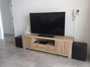 A television and/or entertainment center at Oceanic Unit 19, 8-12 North Street, Forster