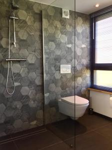 A bathroom at Plek 16 Appartement
