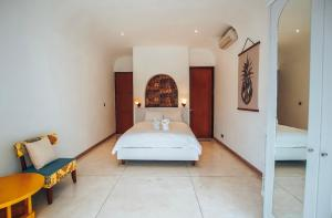 A bed or beds in a room at Nazeki Villa