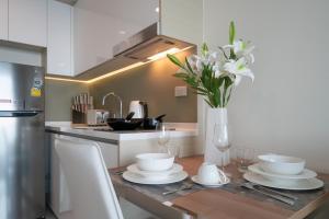 ครัวหรือมุมครัวของ Pattaya Riviera Jomtien Hotel