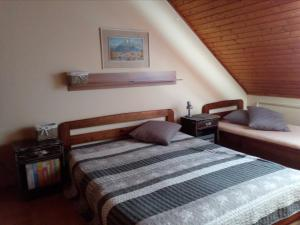 A bed or beds in a room at Apartmany Neuwald
