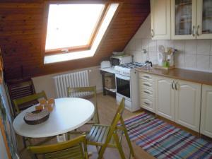 A kitchen or kitchenette at Apartmany Neuwald