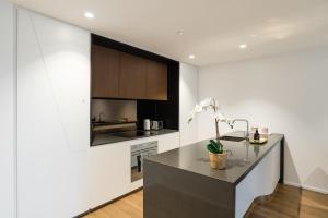 Küche/Küchenzeile in der Unterkunft Apartment CBD - O'Connor