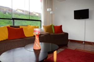 Zona de estar de Sarat´ika Apartamento Cusco