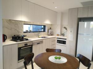 A kitchen or kitchenette at Northcliffe Residences