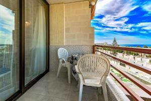 Ein Balkon oder eine Terrasse in der Unterkunft Ocean view Las Americas