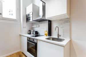 A kitchen or kitchenette at Dreamyflat residence
