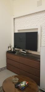 A television and/or entertainment center at Nozol Al Toot Furnished Units