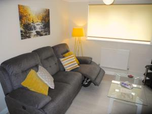 A seating area at Jardine Apartment