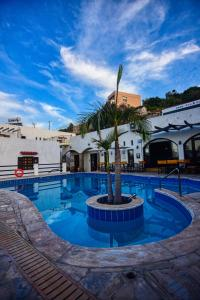 The swimming pool at or near Anny Sea & Sun Apartments