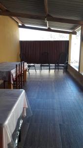 A balcony or terrace at Casa para temporada Bonito MS