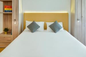 Un ou plusieurs lits dans un hébergement de l'établissement Aparthotel Adagio Monaco Palais Joséphine