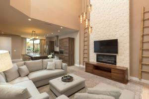 A seating area at Magic Village Views Trademark Collection by Wyndham