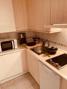 O bucătărie sau chicinetă la Stylish City Apartamentos