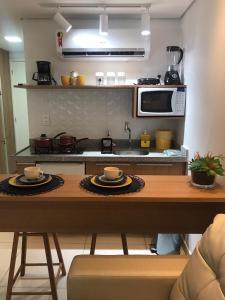 A cozinha ou cozinha compacta de Laguna Beach Flat
