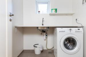 A bathroom at Opal Premium Apartments