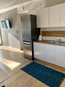 Kuchyňa alebo kuchynka v ubytovaní Grand Spa Holiday Home II