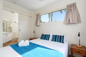 A bed or beds in a room at Rainbow Getaway Holiday Apartments