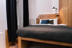 A bed or beds in a room at TG Design Suites Aparthotel Budapest