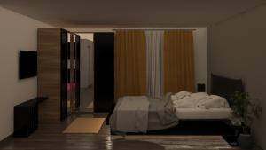 Un pat sau paturi într-o cameră la Benji's Rent