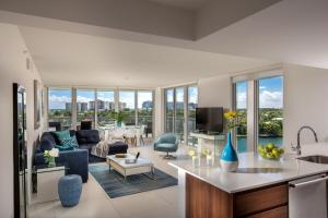 A seating area at Acqua Bay Luxury Apartments