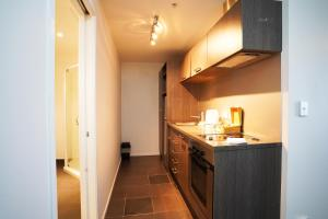 A kitchen or kitchenette at Bianco Off Queen Apartments