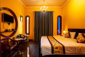 A bed or beds in a room at Dinh Villa