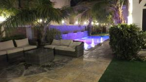 The swimming pool at or near The Paradise on the Palm Villa