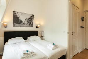 Een bed of bedden in een kamer bij Stayci Serviced Apartments Central Station
