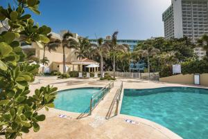 The swimming pool at or near Condado Lagoon Villas at Paseo Caribe