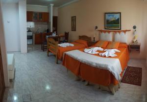 A bed or beds in a room at Complejo El Puente
