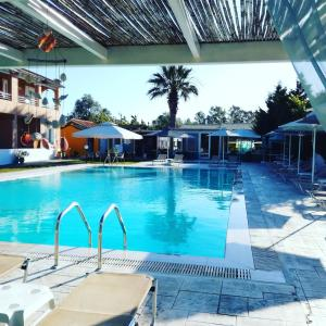 The swimming pool at or near Sausan Hotel