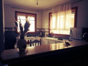 A kitchen or kitchenette at APPARTEMENT LE BIEN ETRE