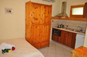 A kitchen or kitchenette at Lysistrata Bungalows